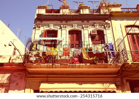 Havana, Cuba - city architecture. Retro balcony. Cross processed color tone - retro style filtered image. - stock photo