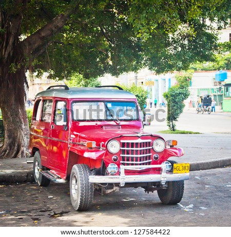 HAVANA, CUBA - DEC 30: Old classic 1950 Willys on December 30, 2012 in Havana, Cuba. With an estimated 60,000 vintage cars still in Cuba, these old classics are a tribute to the nostalgia of the old days. - stock photo