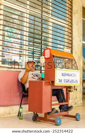 HAVANA, CUBA - DECEMBER 2, 2013: Stand with the repair of glasses, a symbol of the beginning of private business in Cuba, Havana, Cuba - stock photo