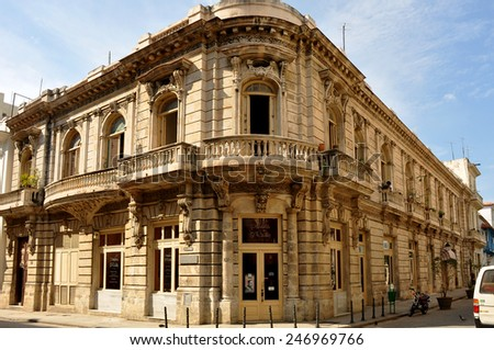 HAVANA, CUBA - FEB 2, 2010: Papeleria O'Reilly building on O'Reilly Street in Havana, Cuba, one of the better kept buildings in the city that has budget problems due to trade embargo.  - stock photo