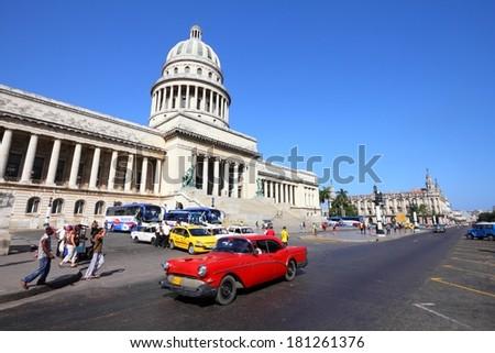 HAVANA, CUBA - FEBRUARY 27, 2011: People drive in Havana, Cuba. Cuba has one of the lowest car-per-capita rates (38 per 1000 people in 2008). - stock photo
