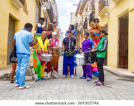 HAVANA,CUBA- JANUARY 24,2016 : Musicians and street dancers in Old Havana - stock photo