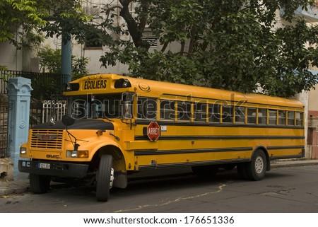 HAVANA, CUBA - JANUARY 31 : Schoolbus on 31 January, 2014, Havana, Cuba. Cuban schoolchildren are transported to school by old American-made schoolbuses. - stock photo