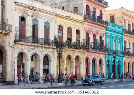 HAVANA,CUBA-JULY 7,2015: After the economic changes and the more flexible rules for construction during Raul Castro government the buildings around Central Park start to gain colors and repairs - stock photo