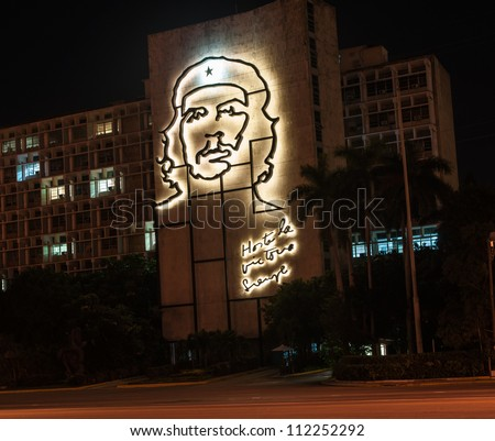 HAVANA, CUBA - JUNE 30: Che Guevara's image in iron, a landmark backlit on the Cuban Ministry for the Interior Building in Revolution Square Havana, Cuba on June 30, 2012. Hasta la victoria siempre in written underneath.