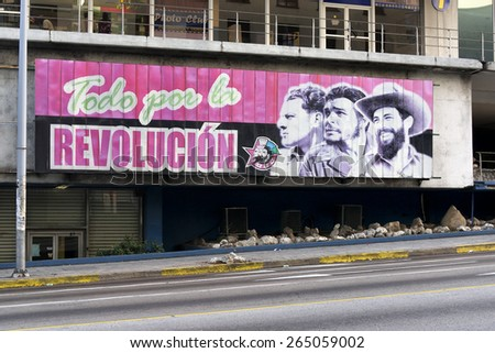 """HAVANA, CUBA - MARCH 21, 2015 - Sign on street in Havana saying, """"all for the revolution."""" - stock photo"""