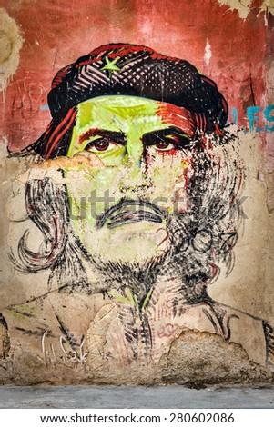 HAVANA,CUBA - MAY 20,2015 : Che Guevara portrait painted on a shabby old wall in Old Havana - stock photo