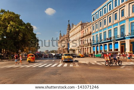 HAVANA, CUBA-MAY 14: Old American cars at Prado Boulevard intersection on May 14, 2013 in Havana. - stock photo