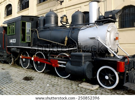 HAVANA, CUBA - NOVEMBER 20: a retro steam engine is parked in a street of the town, on november 20, 2014, in Havana, Cuba. - stock photo
