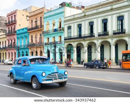 HAVANA,CUBA - NOVEMBER 12, 2015 : Old american car near colorful buildings in Havana - stock photo