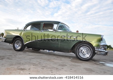 Havana, Cuba - November 27, 2013:  Old green Buick taxi cab seen in Havana, Cuba. - stock photo
