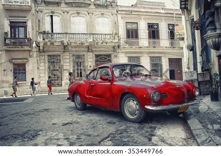 HAVANA, CUBA - 5 OCT, 2008. Red vintage classic American car, commonly used as private taxi parked in Havana street.