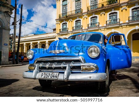 HAVANA, CUBA - OCTOBER 29, 2015 Chevrolet cars are used as taxis on the streets of Old Havana, Havana, Cuba. This is the most common transportation in the capital city