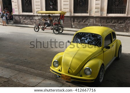 Havana, CUBA - 28 OCTOBER 2012: Old classic American car park on street of Havana,CUBA. Old American cars are iconic sight of Cuba street. - stock photo