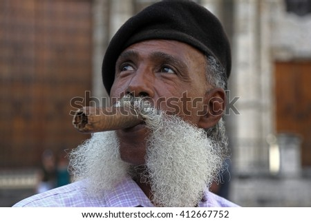 Havana, CUBA - 28 OCTOBER 2012:Portrait of african cuban man smoking cigar in Havana, Cuba. - stock photo