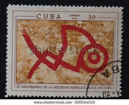 HAVANA,CUBA-REVOLUTIONARY PERIOD: Cuban postal stamp of 1970 showing petroglyphs in Cuban Cave number 2 and commemorating the 30th Anniversary of the Speleological Society of Cuba. - stock photo