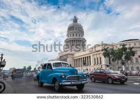 Havana, Cuba - September 22, 2015:  Classic american car and Capitolio landmark in Havana,Cuba. Havana is tourist most popular destination in whole Cuba island. - stock photo