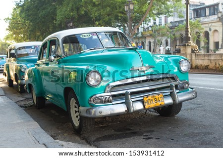 HAVANA, CUBA-SEPTEMBER 10:Vintage Chevrolet parked near El Prado street September 10,2013 in Havana.These old classic cars,mostly used as private taxis, have become a tourist attraction in Cuba