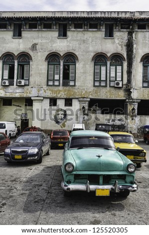 Havana, Cuba. Street scene with old car and worn out buildings.