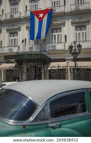 HAVANA/CUBA 4TH JULY 2006 - Old cars in front of the Hotel Inglaterra - stock photo