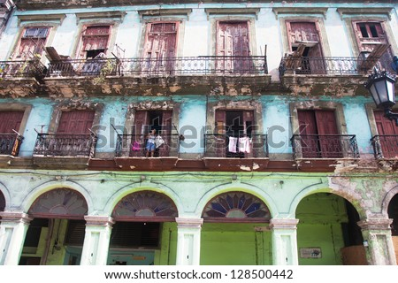 HAVANA-DECEMBER 30:Street in the old part of the city December 30, 2012 in Havana, Cuba. Havana is famous touristic destination of more than 1 million tourists per year - stock photo