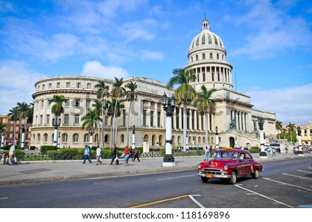 HAVANA-FEB 3:Classic cars in front of the Capitol Feb 3,2010 in Havana.Cubans keep thousands of them running even when parts have not been made for decades and they've become an icon of the country - stock photo