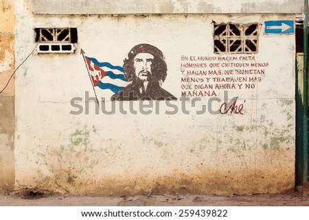 HAVANA - FEBRUARY 17: A grunge graffiti portrait of Che Guevara on a wall February 2015 in Havana, Cuba. After his death, Guevara is considered to be an iconic symbol of revolution worldwide. - stock photo