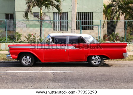 HAVANA - FEBRUARY 24: Classic American car in the street on February 24, 2011 in Havana, Cuba. The multitude of oldtimer cars in Cuba is its major tourism attraction. - stock photo