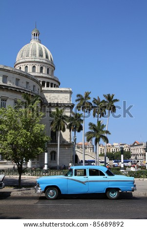 HAVANA - FEBRUARY 26: Classic American car in the street on February 26, 2011 in Havana, Cuba. The multitude of oldtimer cars in Cuba is its major tourism attraction. - stock photo