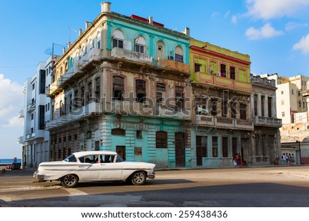 HAVANA - FEBRUARY 17: Classic car and antique buildings on February 17, 2015 in Havana. These vintage cars are an iconic sight of the island