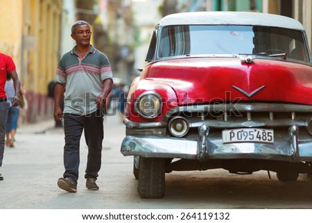 HAVANA - FEBRUARY 25: Classic car and antique buildings on February 25, 2015 in Havana. These vintage cars are an iconic sight of the island