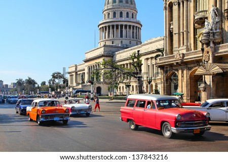 HAVANA - FEBRUARY 27: Cubans drive classic cars on February 27, 2011 in Havana. Recent change in law allows the Cubans to trade cars again. Most cars in Cuba are very old because of the old law. - stock photo