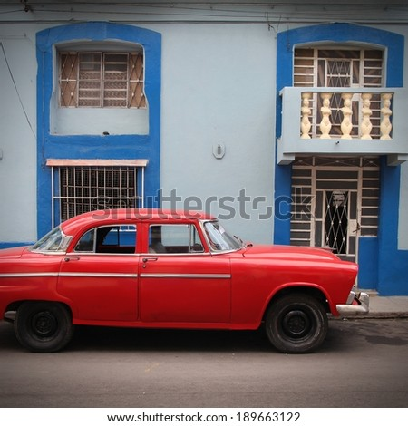 HAVANA - FEBRUARY 27: Oldtimer car parked in the street on February 27, 2011 in Cuba has one of the lowest car-per-capita rates (38 per 1000 people in 2008). - stock photo
