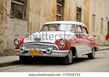 HAVANA - JANUARY 3: A vintage car parked in Havana, Cuba on January 3, 2012.  - stock photo