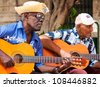 HAVANA-JULY 20:Unidentified musicians playing typical songs for tourists July 20,2012 in Havana.The cuban music and culture is an attraction for more than 2 million people who visit Cuba every year - stock photo