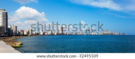 Havana Malecon - Centre and Vedado. High-resolution 120 degrees panorama of Havana's famous embankment promenade. Any part may be cut out as separate image. - stock photo