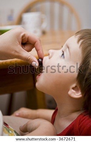 Have a candy, baby - stock photo