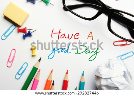 Have a good day concept with some office supplies around it on white background. - stock photo