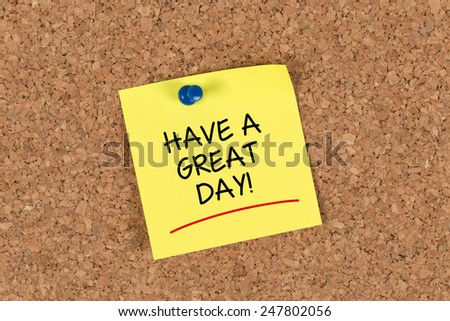 Have a Great Day written on a Yellow Sticky Note on a Cork Board - stock photo