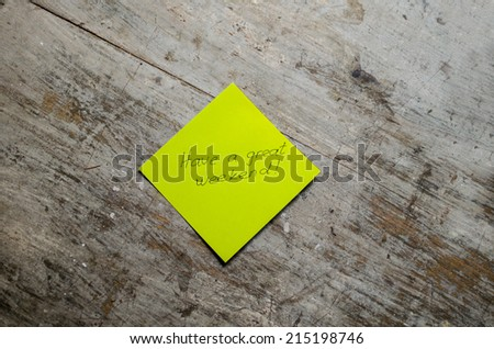 Have a great Weekend - Hand writing text on a piece of paper on wood background with space for text - stock photo