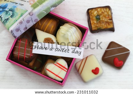 Have a sweet day card with box of chocolates  - stock photo