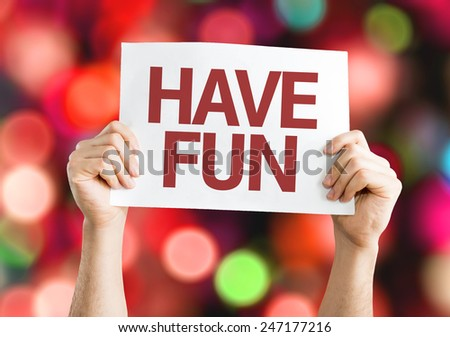 Have Fun card with colorful background with defocused lights - stock photo