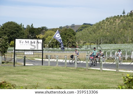 HAVELOCK NORTH ON THE NORTH ISLAND NEW ZEALAND - CIRCA 2014 - A tourist arriving by bicycle to view the Te Mata Wine Estate at Havalock North in the Hawkes Bay region New Zealand