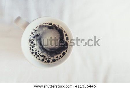 Having a cup of coffee in bed