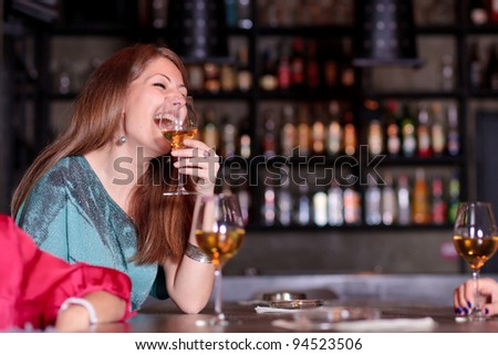 having a good time at the bar - stock photo