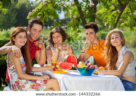 Having a good time at the park. Laughing young people having a good time at the park - stock photo