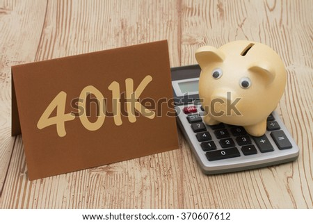 Having a 401k plan, A golden piggy bank, card and calculator on wood background with text  401k - stock photo