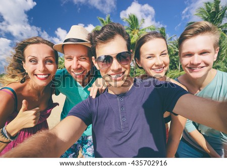 Having fun on the beach together. Vacation with friends. Group of young people taking selfie on the beach. - stock photo