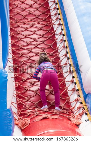 Having fun playing in inflatable jump house.