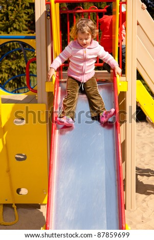 Having fun playing on playground on sunny morning.